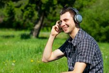 Free Young Man Listening To Music Outdoors Stock Images - 19707184