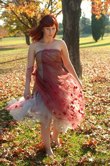 Girl Enjoying A Sunny Autumn Day Royalty Free Stock Photo