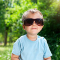 Free Boy Sunglasses In The Summer Park Royalty Free Stock Image - 19715076