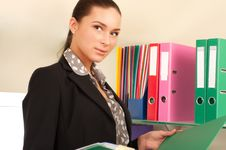 Free Business Woman In Front Of Shelves With Folders Stock Photography - 19710902