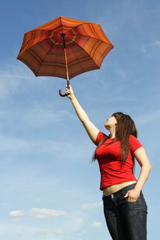 Girl In Red Shirt And With Umbrella, Blue Sky Royalty Free Stock Images