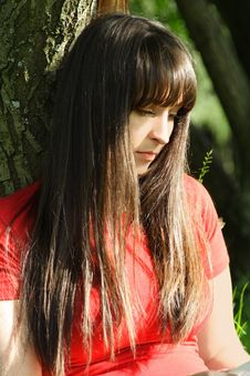 Free Girl In Red Shirt Siting Near Tree Stock Photos - 19712023