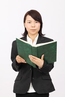 Free Young Asian Business Woman Holding A Book Royalty Free Stock Images - 19712179