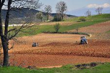 Tractors Plowing