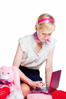 Free Blond Girl Working With Pink Laptop Stock Photography - 19722092