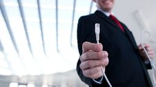 Free Young Businessman Holding An Ethernet Cable Stock Photography - 19724542
