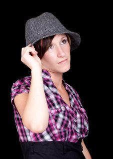 Pretty Girl In A Pink And Black Shirt And A Hat Royalty Free Stock Photos