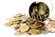 Coins In A Tin Can . Isolated Over White . Royalty Free Stock Photos