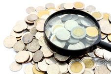 Free Magnifying Glass And Lots Of Gold Coins Stock Photos - 19727103
