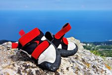Climbing Shoes On A Rock Royalty Free Stock Photography