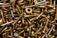 Background Of Old Rusty Screws Royalty Free Stock Photos