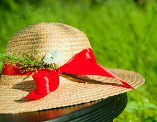 Free Straw Hat With Red Ribbon In The Grass Royalty Free Stock Image - 19730446