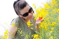 Free Brunette Girl With A Corn Poppy In Her Hand Stock Photo - 19731100