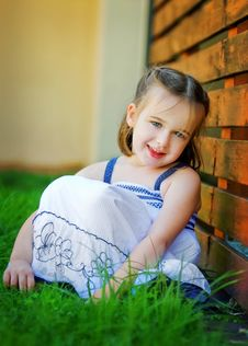 A Sweet Little Girl Looking Happily At The Camera Royalty Free Stock Photo