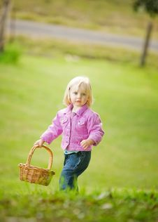 A Cute Little Girl Holding A Basket Royalty Free Stock Photos