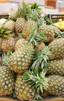 Free Pineapples Stand Royalty Free Stock Images - 19731729