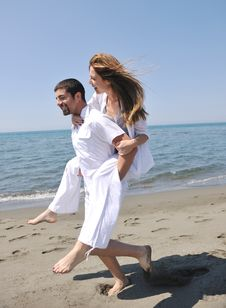 Free Happy Young Couple Have Fun On Beach Stock Photo - 19732370