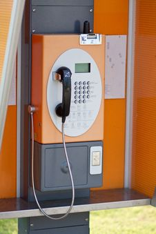 Lonely Orange Public Telephone In Thailand