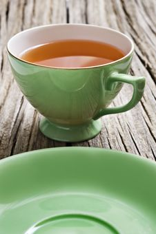 Free One Antiques Cup With Tea Royalty Free Stock Photos - 19732778