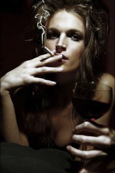 Girl With Wineglass And Cigarette Stock Photos