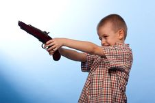 Free Cute Boy Playing With The Gun Royalty Free Stock Photo - 19735065