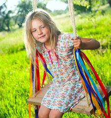 Free Young Girl On Swing Royalty Free Stock Image - 19735116
