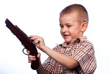 Free Cute Boy Playing With The Gun Royalty Free Stock Photo - 19735485