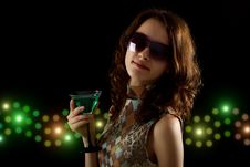 Young Woman With A Green Cocktail Stock Image