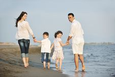 Free Happy Young Family Have Fun On Beach At Sunset Royalty Free Stock Photography - 19736267
