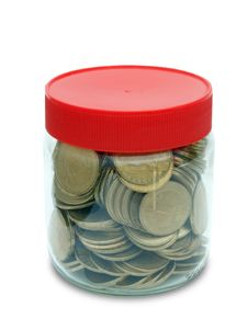 Coin In Jar Stock Photography