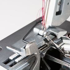 Free Needles With Thread In Overstitching Machine Royalty Free Stock Images - 19736639