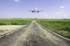 Free Aircraft Landing In A Beautifull Landscape Royalty Free Stock Photos - 19736838