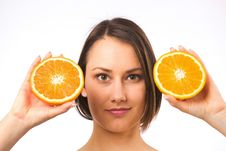 Free Young Woman And Two Halves Of Orange Stock Photo - 19737800