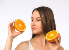 Free Young Woman And Two Halves Of Orange Stock Images - 19737804