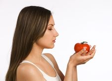 Free Young Woman Looking At A Fresh Tomato Royalty Free Stock Photos - 19737838
