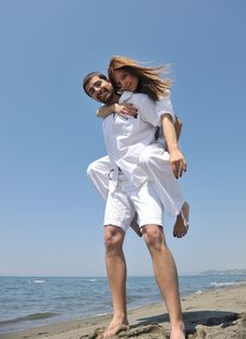 Free Happy Young Couple Have Fun On Beach Stock Image - 19738411