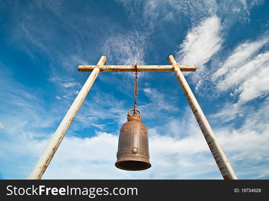 Ancient bell on the mountain with blue sky