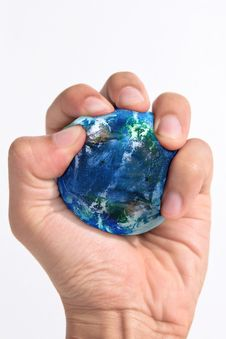 Free Hand Squeezing Earth Royalty Free Stock Photography - 19740487
