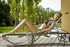 Sexy Young Woman Relaxing On Deck Chair Stock Images