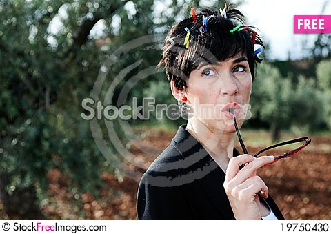 The woman with red glasses in hands Stock Photo