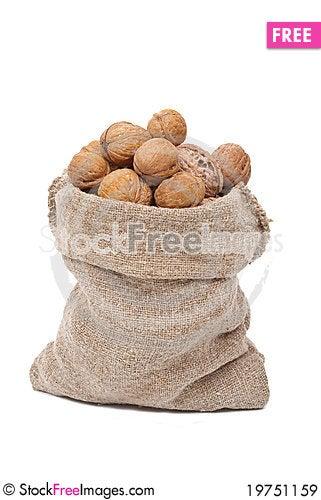 Burlap sack with walnuts Stock Photo
