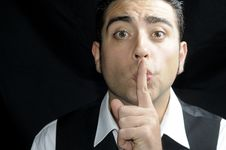 Free Man With A Finger In His Lips Stock Images - 19750434