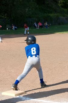 Free Little League Player On Base. Stock Photo - 19750890