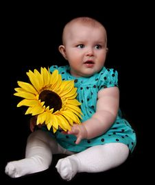Free Infant Girl With Large Golden Sunflower. Isola Royalty Free Stock Image - 19751106