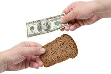 Hands Hold The Dollar And Bread Stock Photo