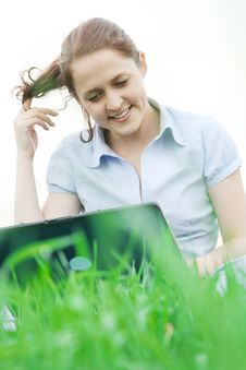 Girl Sitting In The Grass Royalty Free Stock Images