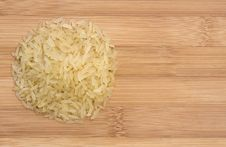 Free Pile Of Raw Rice On Wooden Table Royalty Free Stock Image - 19752076