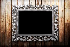 Free Frame On A Wooden Background Royalty Free Stock Photography - 19753127