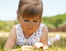 Free Little Girl Lying On Grass In The Park Royalty Free Stock Photos - 19753388