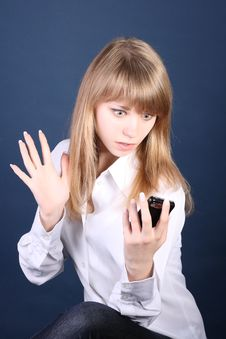 The Young Girl Looks At Phone With Surprise Stock Photos